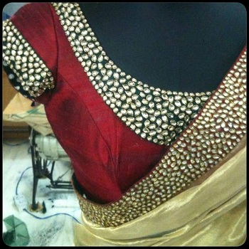 Kundan work on silk blouse