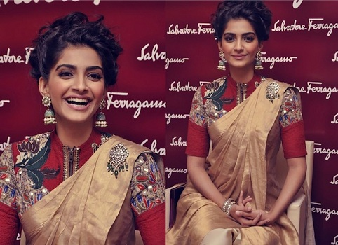 Sonam kapoor in plain beige saree with front zipped blouse