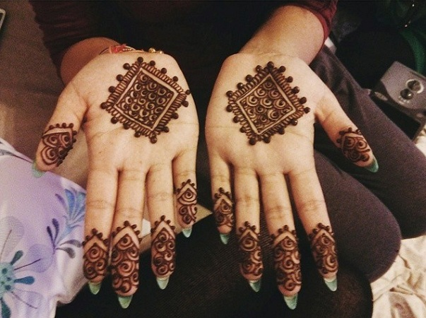 Minimalist mehendi design for palm