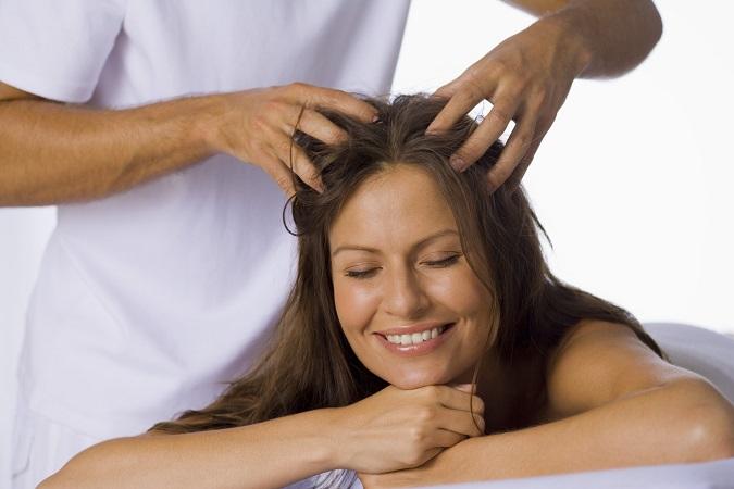 Woman having a scalp massage